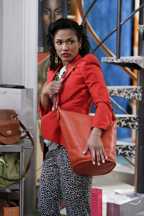 Larissa-accessorized-her-fitted-red-blazer-orange-leather